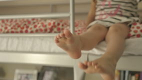 A child climbs the stairs to the bed, shooting in slow motion 96 fps