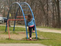 The child climbs on toys on the playground royalty free stock photo