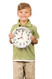 Child with clock Stock Photos