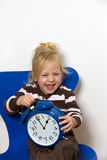 Child with a clock icon DST changeover Royalty Free Stock Photo