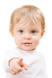 Child close-up portrait. Child pointing at you - portrait isolated on white Stock Image
