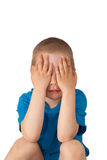 Child closed eyes with his hands. Child pressed his hands to his head on white royalty free stock photo