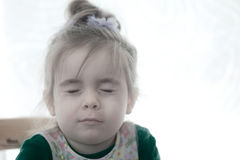Child with closed eyes Stock Photography