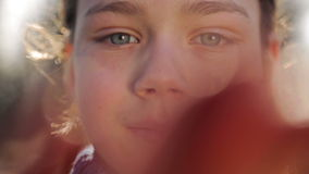 The child closes a hand lens of the camera. Portrait of a boy close up, open and close the camera. stock video footage