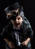 Child closeup steampunk. On black background Stock Photos