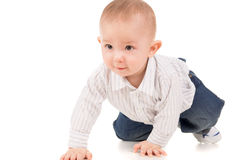 The child in clothes crawling on the floor Stock Photography