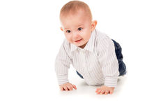 The child in clothes crawling on the floor Royalty Free Stock Photo