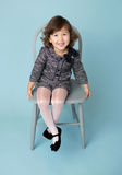 Child Clothing Fashion. Child and kids fashion and clothing: girl in modern outfit on blue background Stock Photography
