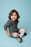 Child Clothing Fashion. Child and kids fashion and clothing: girl in modern outfit on blue background Stock Image