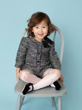 Child Clothing Fashion. Child and kids fashion and clothing: girl in modern outfit on blue background Royalty Free Stock Image