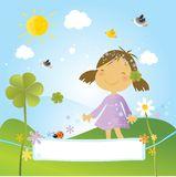 Child with clover. Happy girl in the park with clovers, flowers and birds in a spring day. Nice banner for your text Stock Photo