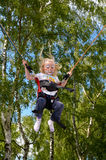 Child clown. Jumping has fun Stock Image