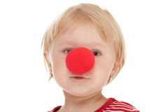 Child with clown nose. Studio shot of child with clown nose Stock Photo