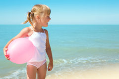Child on coast of sea Royalty Free Stock Image