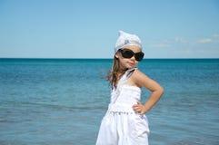 Child on coast of sea Royalty Free Stock Photo