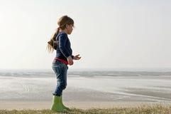Child on coastline Royalty Free Stock Image