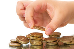 Child  with coins Stock Photos