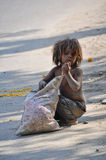 Child collecting garbage. In India stock photography
