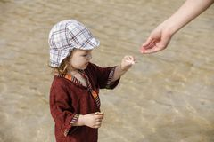 Child collecting shells on tropical beach Royalty Free Stock Photo