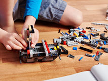 Child collects plastic building kit Royalty Free Stock Image