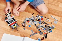 Child collects plastic toy building kit Royalty Free Stock Images