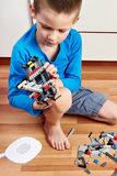Child collects plastic toy building kit Stock Photo