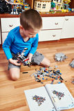 Child collects plastic toy building kit Stock Images