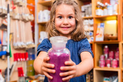 Child with color or paint pigments in store Stock Photos