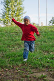 Child of color that runs. Color baby running in a meadow Royalty Free Stock Photo