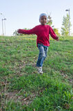 Child of color that runs. Color baby running in a meadow Stock Photos