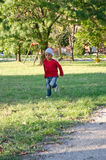 Child of color that runs. Color baby running in a meadow Royalty Free Stock Photography