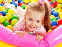 Child in colored ball. Stock Photos