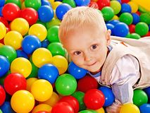 Child in colored ball. Royalty Free Stock Image