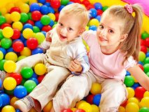 Child in colored ball. Royalty Free Stock Photos