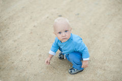 Child in colored balls. In a dry basin Stock Photos