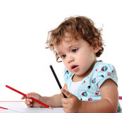Child with colored pencils Royalty Free Stock Image
