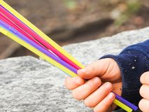 Child with colored straws in hand. Child with colorful straws in hand, deciding to choose a color Stock Photos