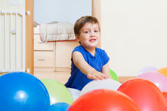 Child  with colorful balloons Stock Images