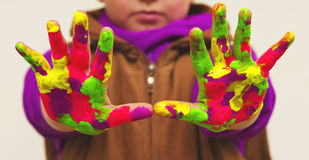 Child with colorful hands Royalty Free Stock Image