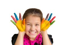 Child with colorful painted palms and hands with color paints. The happy child laughs. Child with colorful painted palms and hands with color paints. Education royalty free stock photo
