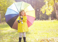 Child with colorful umbrella Royalty Free Stock Photography