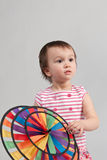 Child with colorful windmill toy Stock Images