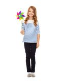 Child with colorful windmill toy Stock Photos