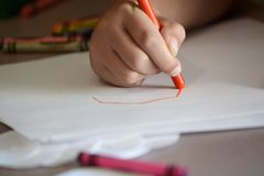 Child Coloring on Blank White Paper with Color Crayons Stock Photography