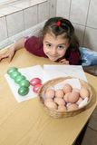 Child coloring easter eggs. Happy Child girl coloring easter eggs Stock Image