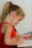 Child coloring - funny face Royalty Free Stock Photo