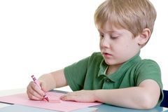 Child Coloring a Heart Royalty Free Stock Photography