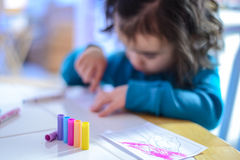 Child coloring. With markers at kitchen table Stock Photo