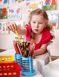 Child  with colour pencil in preschool. Stock Images
