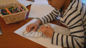 Child colouring a picture stock footage